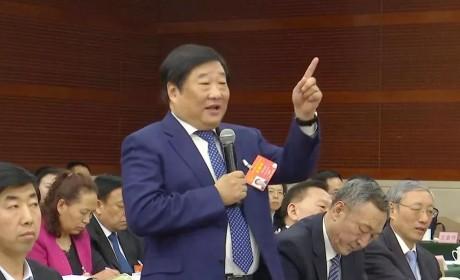 谭旭光两会答记者问,要把中国重汽打造成世界一流品牌